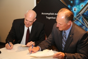 Greater Omaha Chamber President David Brown and GFDC President Scott Meister sign the partnership agreement.- May 22, 2013